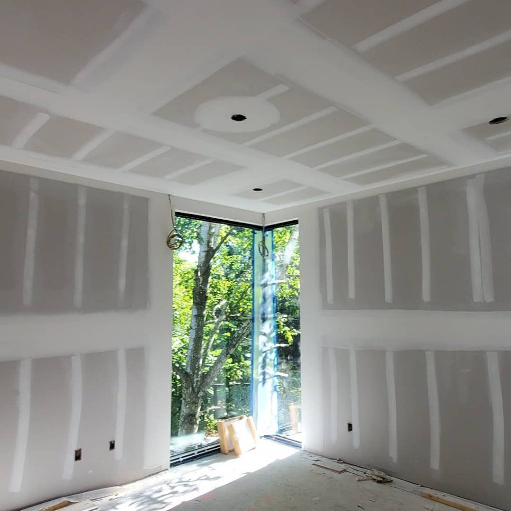 luxury bedroom with finished drywall and glass window corner -  drywall installation toronto