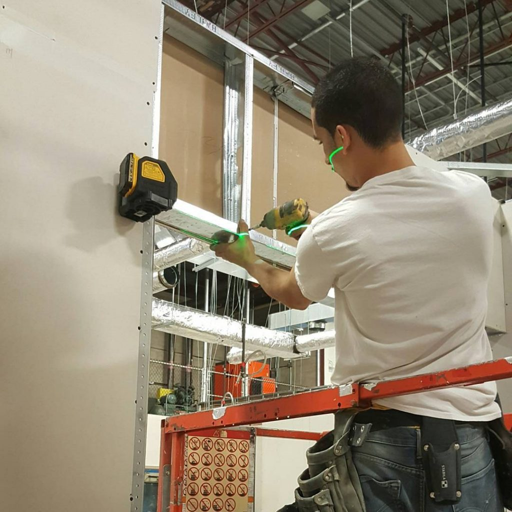 carsie team working on installing metal frame - commercial drywall contractors toronto