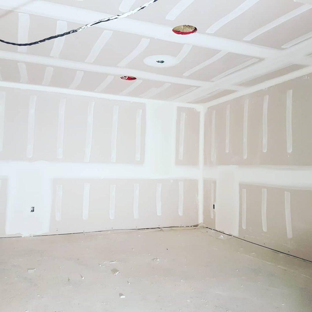 installing drywall in custom basement - residential drywall company