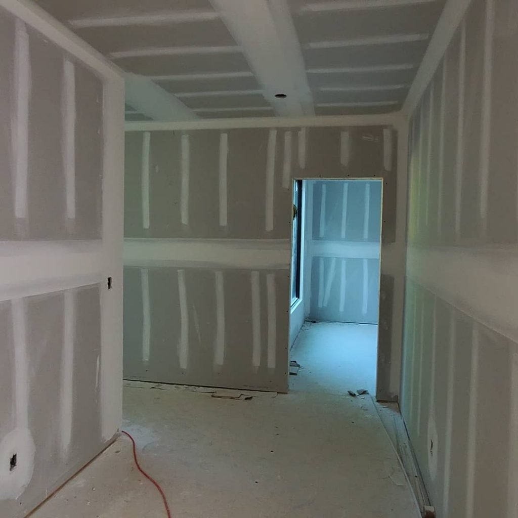 custom home with new drywall in the hallway - drywall company