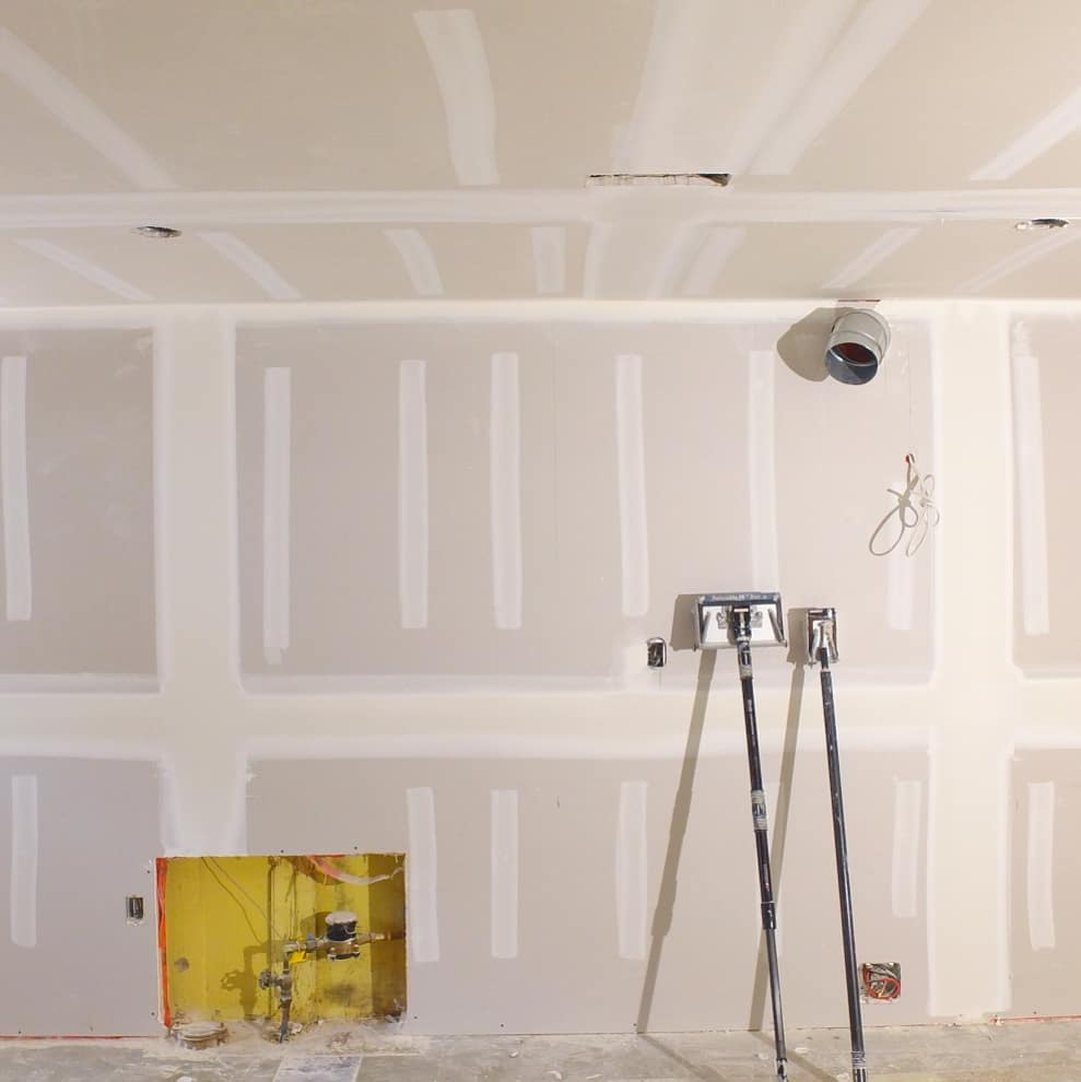 custom build in fire place space at luxury new drywall in living room - drywalling a ceiling