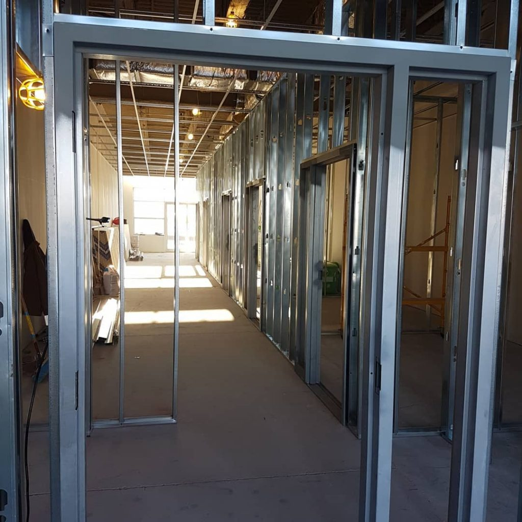 metal frame install for drywall in office building - commercial drywall contractors toronto