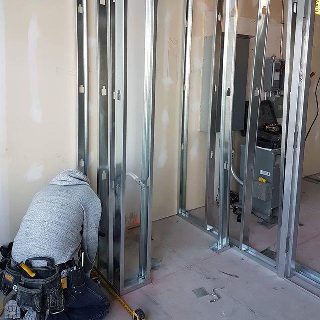 carsie team installing metal frame in preparation for drywall installation - drywall installation toronto