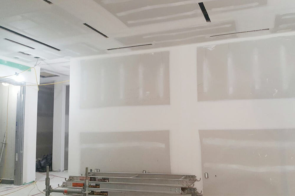 finished drywall in the basement - drywall installation by carsie team