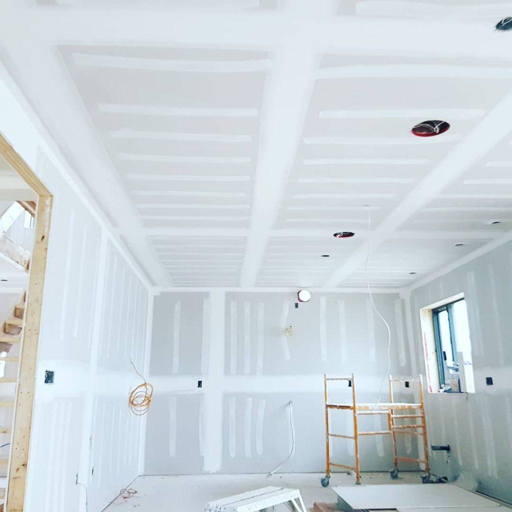 custom living room with fresh drywall installation - drywall company