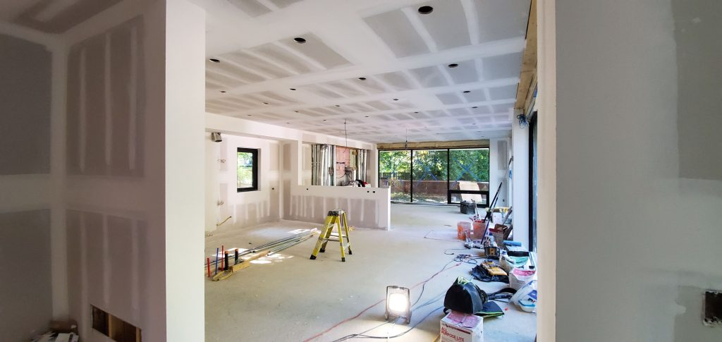 walk in basement with finished drywall installation - drywalling a ceiling